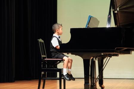 Japanese boy playing piano photo