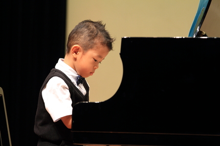 Japanese boy playing piano photo