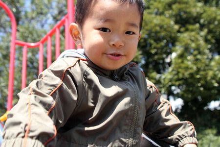 Japanese boy on the slide (2 years old) photo