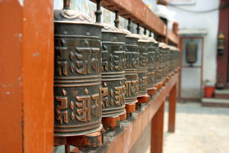 Mani wheel at Boudhanath in Kathmandu, Nepal photo