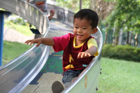 Japanese boy on the slide (3 years old) photo