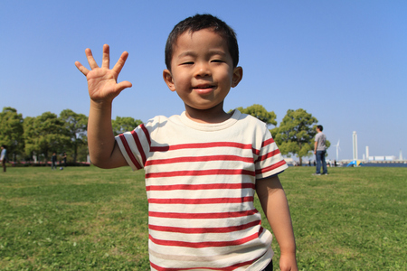 Japanese boy playing with rock-scissor-paper (3 years old) photo