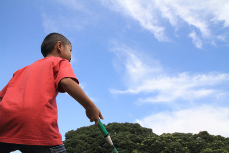 5 10 years old: Japanese boy playing badminton (5 years old) Stock Photo