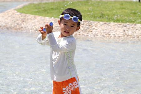 water gun: Japanese boy with water gun (3 years old)