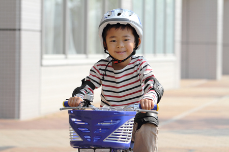 5 years: Japanese boy riding on the bicycle 5 years old
