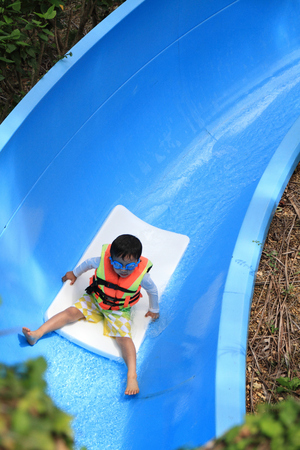 5 10 years old: Japanese boy on the water slide 5 years old