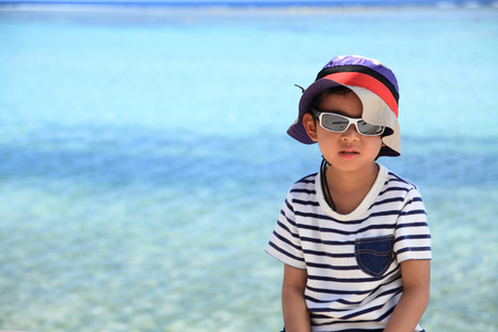 5 10 years old: Japanese boy and blue ocean 5 years old