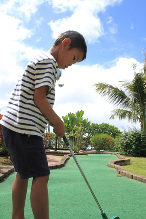 5 years: Japanese boy playing with putting golf 5 years old Stock Photo