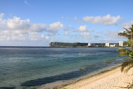 micronesia: Two lovers point from Tumon beach in Guam Micronesia