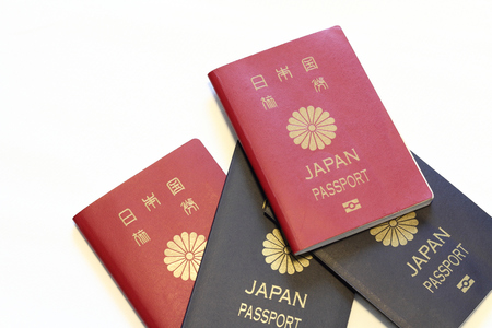 oversea: Japanese passports (red and blue) Stock Photo