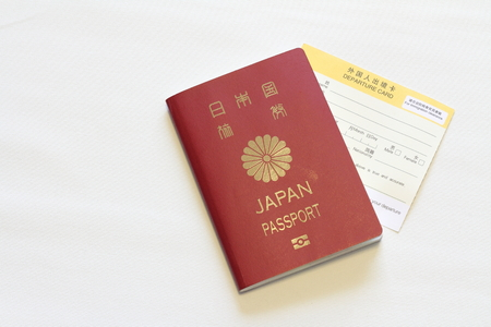 oversea: Japanese passport and immigration card (red) Stock Photo