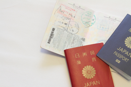 foreign country: Japanese passport and visas on the passport (red) Stock Photo