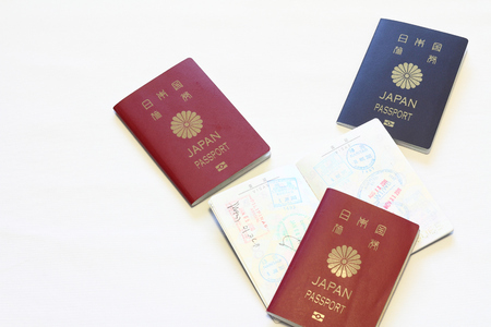 oversea: Japanese passport and visas on the passport (red) Stock Photo
