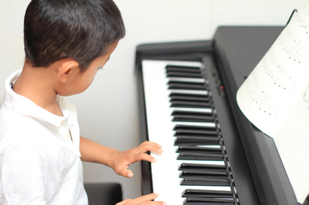 5 years: Japanese boy playing a piano (5 years old)