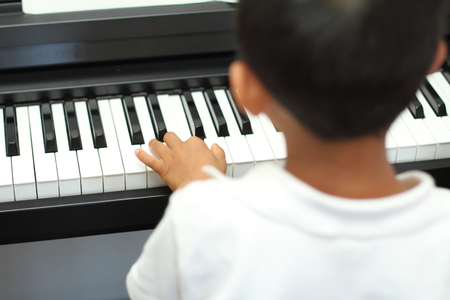 5 years old: Japanese boy playing a piano (5 years old)