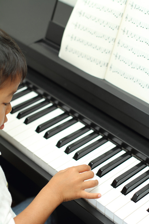 5 10 years old: Japanese boy playing a piano (5 years old)
