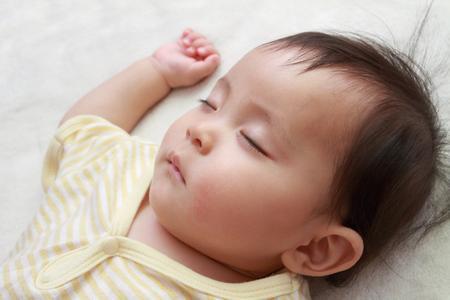 snoozing: Sleeping Japanese baby girl (0 year old)