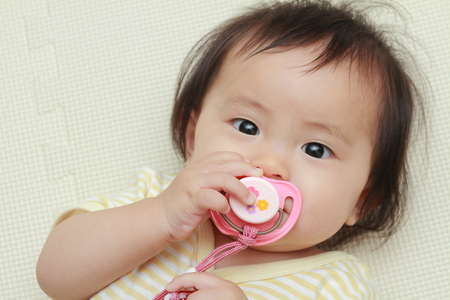 nipple girl: Japanese baby girl sucking on a pacifier (0 year old)