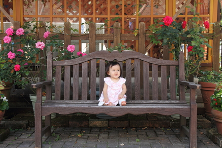 one year: Japanese baby girl sitting on the bench Stock Photo