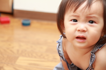 Crying Japanese baby girl (0 year old) 写真素材