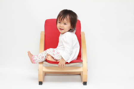 baby sit: Japanese baby girl sitting on the chair (0 year old)