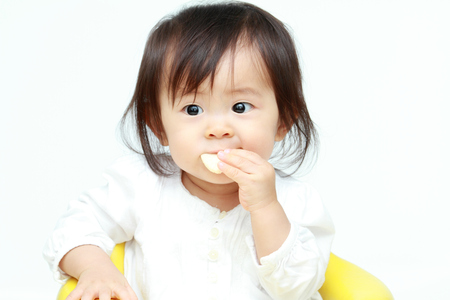 cute lady: Japanese baby girl eating rice cracker (0 year old)