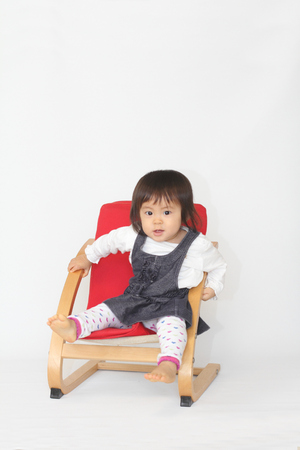 1 year old: Japanese baby girl sitting on the chair (1 year old)