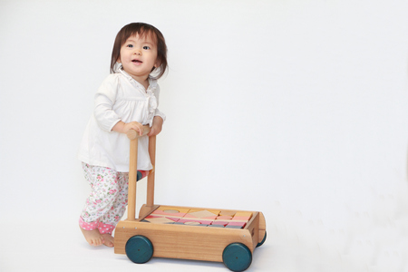 Japanese baby girl pushing a cart (1 year old)