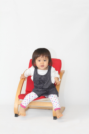 baby sit: Japanese baby girl sitting on the chair (1 year old)