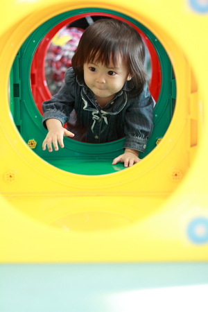 1 year old: Japanese baby girl passing through a tunnel (1 year old)