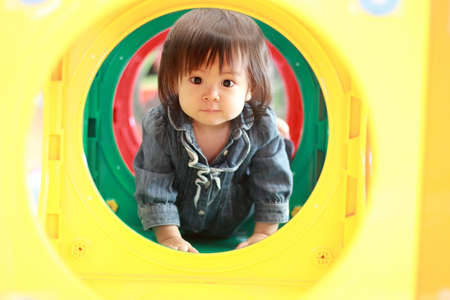 Japanese baby girl passing through a tunnel (1 year old)