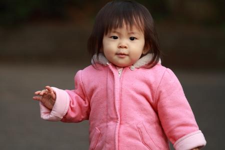 swaying: Japanese toddling girl (1 year old) Stock Photo