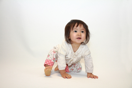 1 year old: Japanese baby girl sitting on the floor (1 year old)