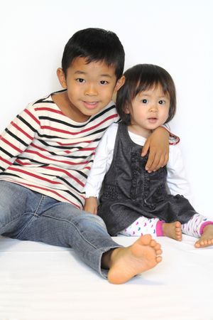 6 year old: Japanese brother and sister hugging each other (6 years old boy and 1 year old girl)