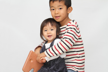 6 year old: Japanese brother and sister playing with rocking horse (6 years old boy and 1 year old girl)