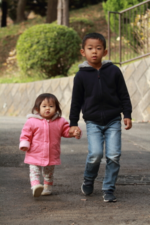 6 year old: Japanese brother and sister taking a walk (6 years old boy and 1 year old girl)