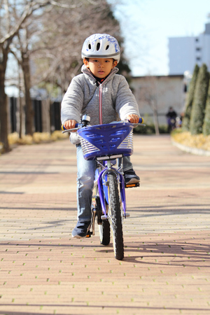 6 years: Japanese boy riding on the bicycle (6 years old)