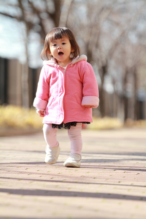 Japanese toddling girl (1 year old) 写真素材