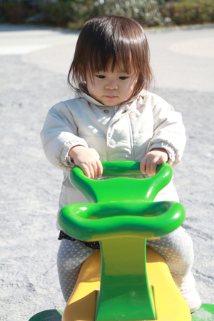 1 year old: Japanese baby girl on the seesaw (1 year old)