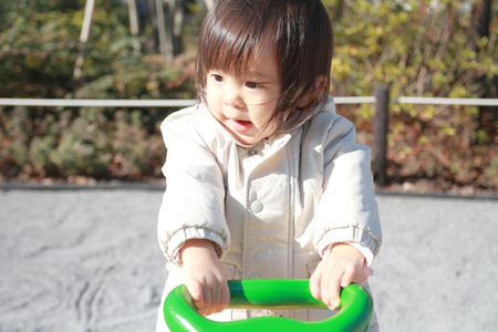 totter: Japanese baby girl on the seesaw (1 year old)