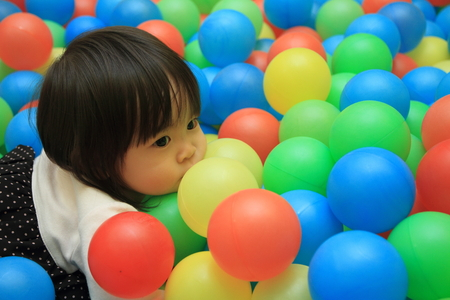 1 year old: Japanese baby girl playing in ball pool (1 year old)