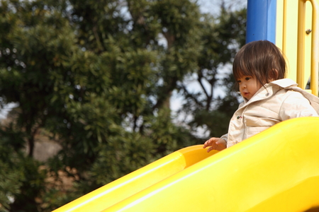 1 year old: Japanese baby girl on the slide (1 year old) Stock Photo