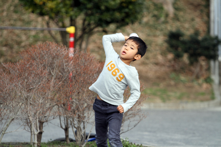 Japanese boy playing catch (6 years old) Stock Photo