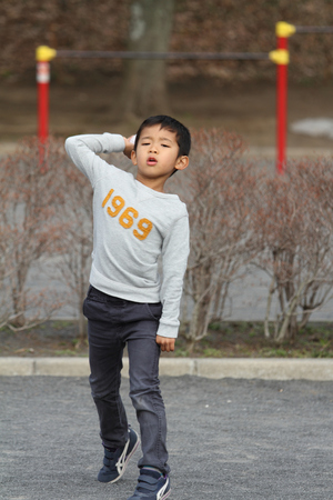 6 years: Japanese boy playing catch (6 years old) Stock Photo