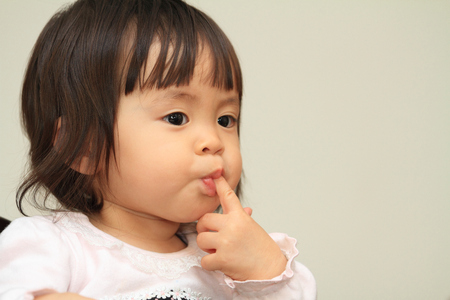 10 fingers: Japanese baby girl sucking her finger (1 year old)