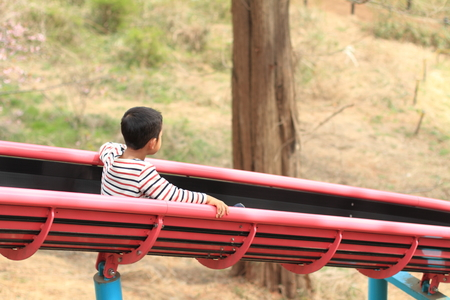 6 years: Japanese boy on the slide (6 years old)