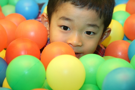 6 years: Japanese boy playing in ball pool (6 years old) Stock Photo