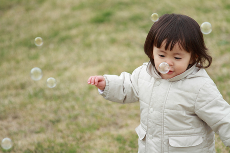 1 year old: Japanese baby girl playing with bubble (1 year old)