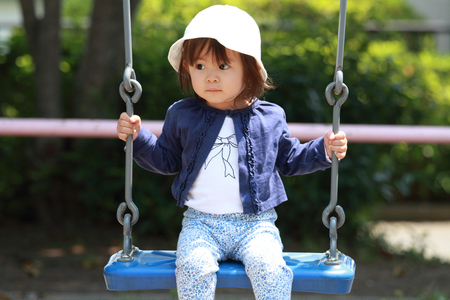 1 year old: Japanese girl on the swing (1 year old)
