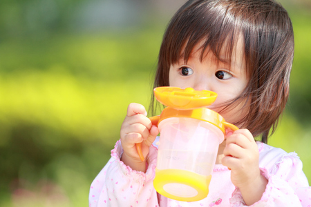 1 year old: Japanese girl drinking water (1 year old)